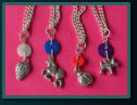 White Strawberry, Blue Unicorn, Red Ladybird and Purple Dog Child's Button Necklaces