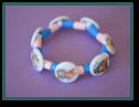 Child's Wooden Bracelet made with customer's buttons.